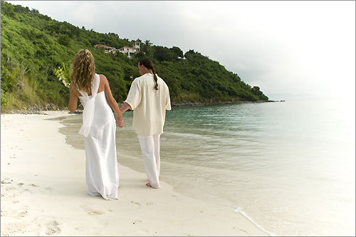 Ruth Duncan and Jason WIlson stroll along White Bay Beach in Jost Van Dyke following their wedding.