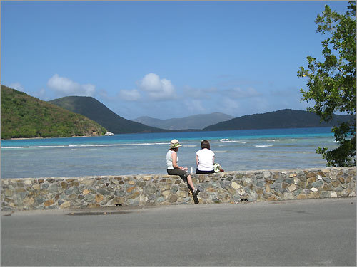 Steven Auster's wife and daughter sip smoothies while sitting on the edge of Leinster Bay, St John last month.