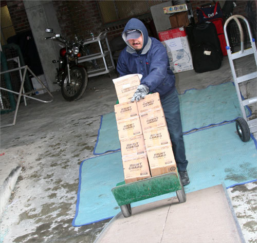 Boxes labeled 'Right Guard' were part of the early load. Golf clubs, bats, and other more familiar spring training items will be loaded on last.