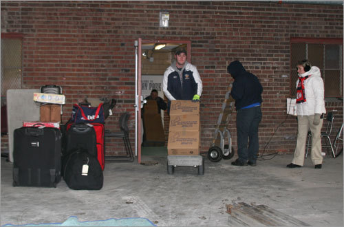 The movers bring gear and supplies from the Red Sox clubhouse out to the truck on Van Ness Street.