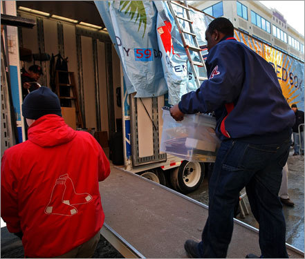 Workers loaded the truck with equipment for spring training.