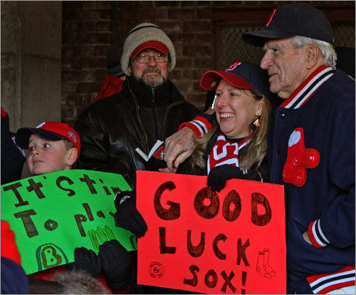 Red Sox fan Donna Campbell (center) of Abington posed for a picture with Johnny Pesky.