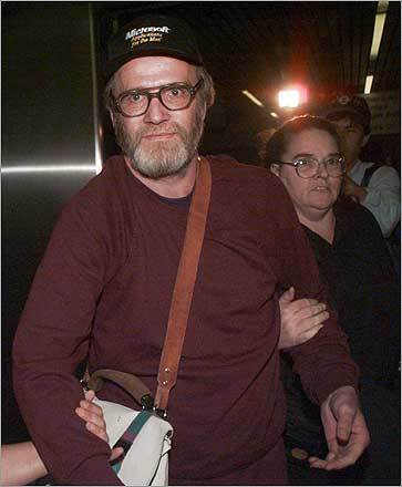 After his release from federal prison in Oklahoma in 1995, Lewis and his wife, LeAnn, moved to Cambridge. He has always maintained his innocence in the Tylenol murders. At left, Lewis arriving in Logan Airport in 1995.