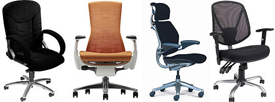 Left to right, Sealy Posturepedic High Back Executive Chair, Herman Miller Embody, Humanscale Freedom, and Staples Acadia Multifunction Mesh Task Chair.
