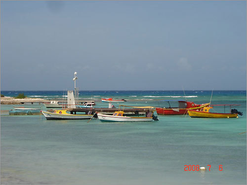 Boats docked off the coast of Roger's Beach in Aruba.