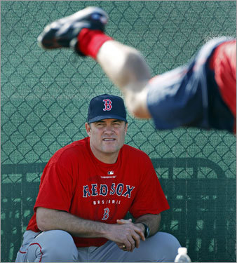 Pitching coach John Farrell stayed in the shade as he watched Beckett do some throwing on Wednesday morning.