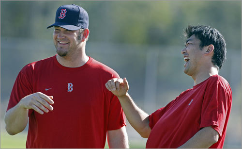 New pitchers and former Los Angeles Dodgers teammates Brad Penny (left) and Takashi Saito had a laugh Wednesday morning.