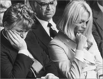 Ted and Joan with heads bowed at the John F. Kennedy Presidential Library dedication.