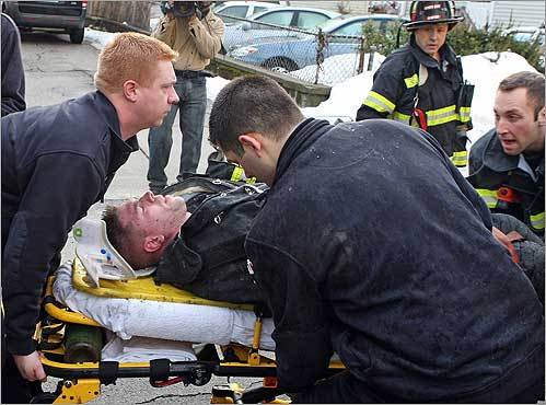 This firefighter was conscious as he was carried out on a stretcher from the scene. WCVB-TV Channel 5 reported that the firefighter fell through two floors. A witness at the scene also said he saw two people being loaded into an ambulance, one of whom appeared to be a teenager with a hand burn. Channel 5 reported that they were a mother and son, which could not immediately be confirmed.