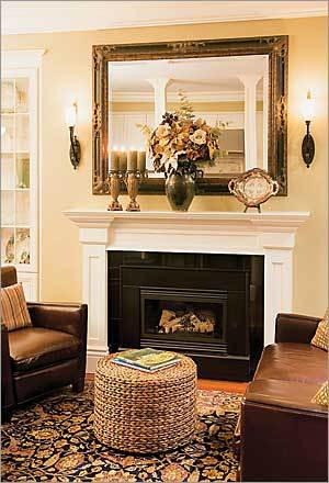 "Traditional Touch-Up Boston's Lisa Boucher disliked the mantel in her Marlborough Street condo so much that she asked a worker to start ripping it off the wall before she had a replacement. ""It was very contemporary, very plain,"" says Boucher. ""It wasn't much of a mantel. It was more like a big picture frame."" Unable to find a prefab mantel that fit the opening, she turned to carpenter Greg Treleaven to design something that befit her 1899 space. ""It's wonderful,"" she says. ""Now I can actually decorate it for the holidays."""