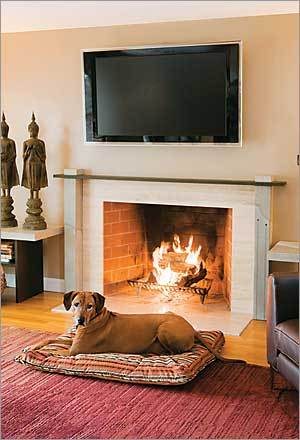 "Touch of Cool Huub Valkenburg, of Marblehead, added style to an existing limestone fireplace with concrete support columns and a new mantel (which is Richlite, made primarily of paper). The concrete gave him the opportunity to display two 17th-century gold coins he had found in a shop in India, now imbedded in the right column. Indeed, that can be almost a drawback, says Jordan Castro of Aggregate Designs, which did the fireplace work. ""Because you have so many options,"" Castro says, ""it's almost impossible to decide."""