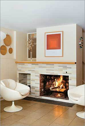"Retro Update After her husband died, Sarah Hazel decided to finish the renovation he had designed for the fireplace in their Concord home. He had chosen handmade tiles from Trikeenan Tileworks of Keene, New Hampshire, to match the kitchen's backsplash. The old fireplace ""was just really, really understated, to the point where no one even noticed it,"" Hazel says. The white tiles, in a style Trikeenan calls Big Skinny Brick, are a combination of three of Trikeenan's 97 glazes. ""People that come in love the tile,"" says Hazel. ""And for me, it has that special meaning."""