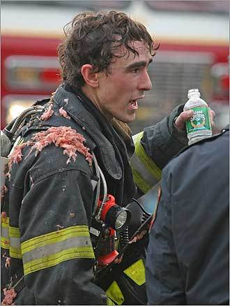 Covered in insulation, firefighter Greg Gentile took a short break.