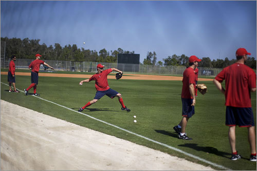 Red Sox pitcher Clay Buchholz (center) did some throwing with his teammates.