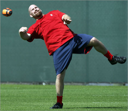 Kevin Youkilis threw a football during breaks in conditioning.