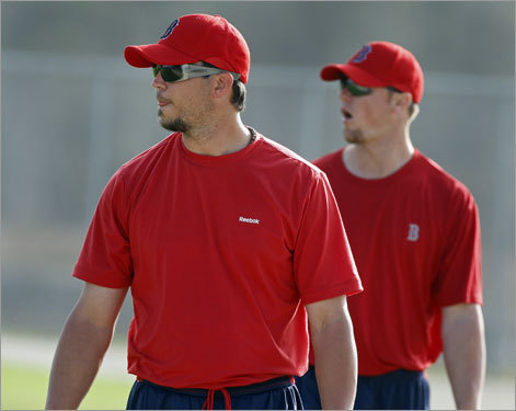Red Sox pitcher Josh Beckett (front) and Jon Lester (rear) are seen together as they walked off the field after throwing.