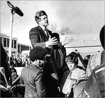 Kennedy stands in the trunk of his limousine to address students at the University of Northern Iowa.