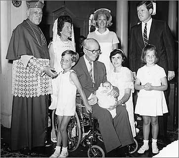 Newborn Patrick Joseph Kennedy (in his grandfather's lap) and his family on the day of his baptism by Boston's Cardinal Richard J. Cushing.