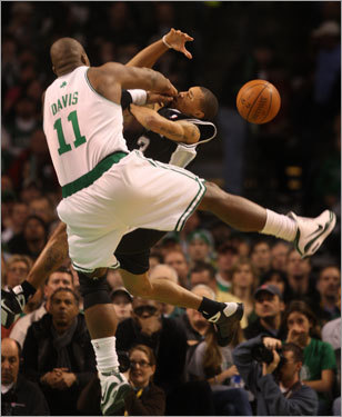 Celtics center Glen Davis, known as 'Big Baby,' for his large stature on and off the court, clobbers San Antonio guard George Hill during a game at TD Banknorth Garden. The Globe's Stan Grossfeld followed Davis to experience a day in the life of the Celtics star. Click here to read about a day in the life of Big Baby.