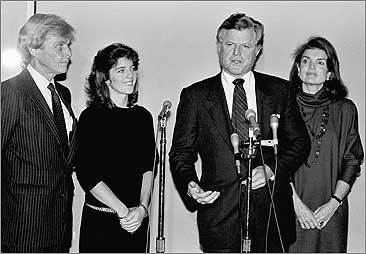 Senator Edward Kennedy speaks as Jacqueline Kennedy Onassis, right, stands by his side in 1983. At left, is Stephen Smith, Kennedy's brother-in-law, and Caroline Kennedy.