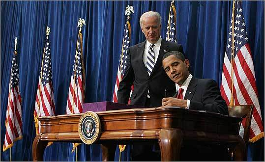 Vice President Joe Biden stood behind President Barack Obama as he signed the $787 billion economic stimulus bill at the Museum of Nature and Science in central Denver Tuesday.