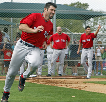 Red Sox catcher Jason Varitek has a smile on his face as he heads up the first base line during a base running drill in Fort Myers on Thursday. Kevin Youkilis and Jacoby Ellsbury wait their turns in the background.