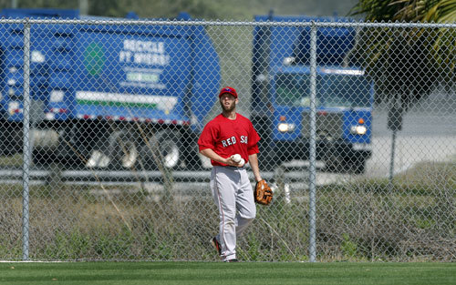 Red Sox second baseman Dustin Pedroia is known as a 'trash talker,' so, as he shags in left field during batting practice, perhaps it is appropriate that a couple of city of Fort Myers trucks make their way to the city yard that is located behind one of the practice fields.