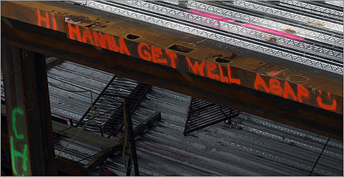 Over the last month, the ironworkers have painted more than 100 names on the building and emblazoned part of their crane with a likeness of SpongeBob SquarePants. They have also painted a few special messages on the steel, like 'Hi Hanna Get Well ASAP :)' Read the story