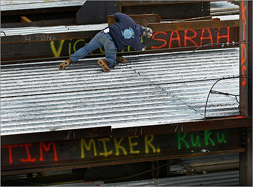 Construction worker Dana Morss wrote a name on a beam.