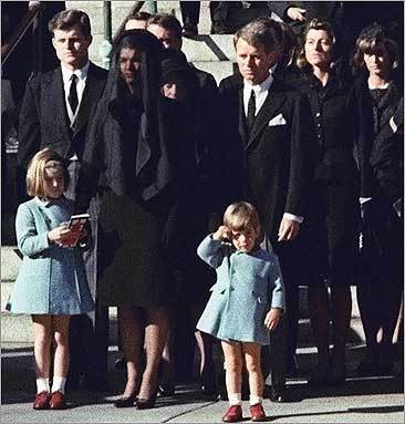 Three-year-old John F. Kennedy Jr. salutes his father's casket in Washington on Nov. 25, 1963, three days after the president was assassinated in Dallas. Jacqueline Kennedy and daughter Caroline Kennedy are accompanied by Edward Kennedy (left) and Robert Kennedy.
