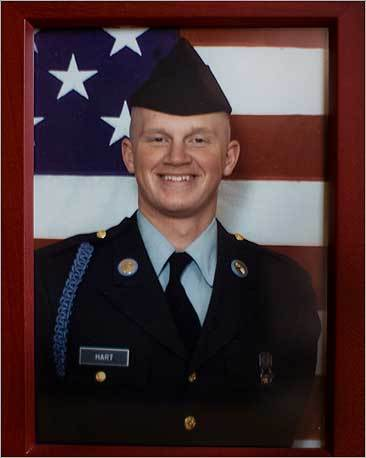 A portrait of Private First Class John D. Hart, who was killed by a roadside bomb in Iraq in 2003. After his death, John's parents, Brian and Alma Hart, worked with Senator Kennedy to get better armor for US soldiers. The Harts told Kennedy that their son had been ambushed while riding in a canvas-topped Humvee that had no armor, no bulletproof shields, not even a metal door.