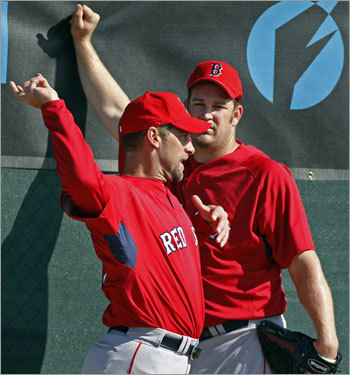 Red Sox pitcher John Smoltz (left) was showing fellow hurler Brad Penny (right) a few tips on his pitching motion after Penny was finished throwing.