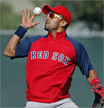 Red Sox shortstop Julio Lugo bobbled a ball during a fielding drill, but he recovered and made the play.