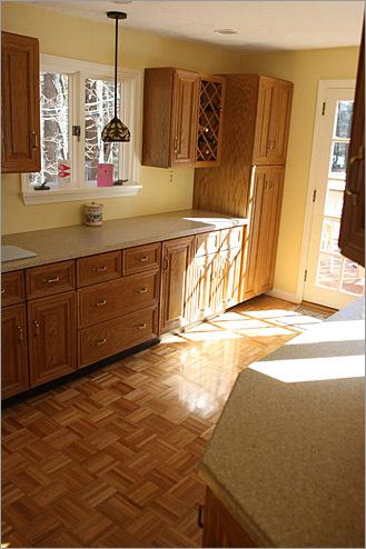 Large amounts of morning sunlight adorn the kitchen.