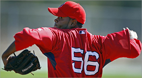 Red Sox pitcher Ramon Ramirez throws live batting practice.