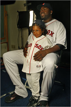 David Ortiz and his young son posed in Red Sox jerseys.