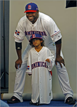 When Red Sox slugger David Ortiz posed with his Dominican Republic jersey, he was joined for a few frames by his son D'Angelo, and the jersey didn't quite fit the youngster.