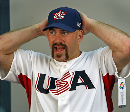 Sunday was Picture Day for the Red Sox in Fort Myers, as players and coaches, including Kevin Youkilis (pictured in his World Baseball Classic jersey and sporting his new Fu Manchu look) had their official photographs taken for card companies, promotional materials, and the like. While the official photos can be boring, the team often has a little fun between takes . . .