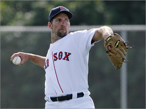 Pitcher John Smoltz throws during workouts.
