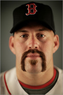 Kevin Youkilis posed (with his new facial hair) during photo day at the Red Sox spring training complex.