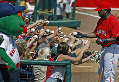Before Wednesday's opening game Red Sox DH David Ortiz signed some autographs down the left field line.