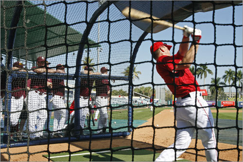 As the Red Sox were taking batting practice, the college players were around the batting cage watching the pros hit, including J.D. Drew (right).