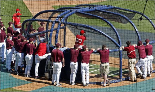 The Red Sox kicked off the Grapefruit League season with a game at City of Palms Park vs. Boston College on Wednesday afternoon. Hours before the game, the college players were around the batting cage watching the pros hit. A group of players watched J.D. Drew take some swings.