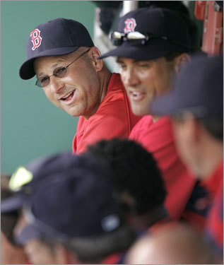 Manager Terry Francona smiles as he sits in the dugout during Thursday's game.