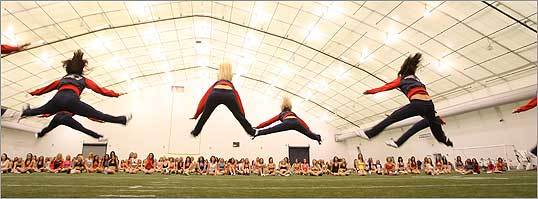 Patriots' cheerleaders demonstrated high jumps.