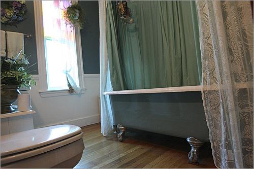 The second floor bathroom includes a clawfoot tub.