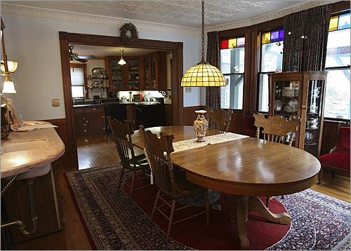 The dining room, with seven windows, has its own bar sink.