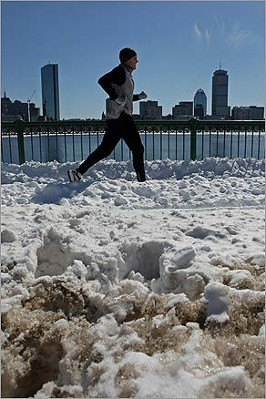 On April 20, runners from around the world will descend upon Boston for the 113th Boston Marathon . Local runners have braved the elements this winter to prepare for the race. Left: On March 4, runners trained along the Charles River despite the snowy ground.