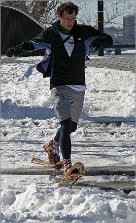 Ryan Prentiss of Boston wore snowshoes to beat the snow while training along the Esplanade.
