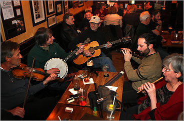 The Snug Hingham The Snug is a pub/restaurant in Hingham that holds a traditional Irish seisiun every Monday evening. The musicians are, from left, Dan McDonald of Marshfield, fiddle; Bob Littera of Harvard, tenor banjo; Kevin Weston of Lakeville, guitar; Donpaul Nogueira of Weymouth, Irish flute; and Mary Nuhibian of Norfolk, the tin whistle. 116 North St., 781-749-9774. Live music four nights a week.